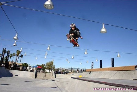 A young skate boarder doing a trick in the air