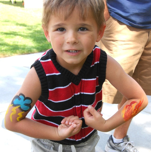 Boy showing his painted arms